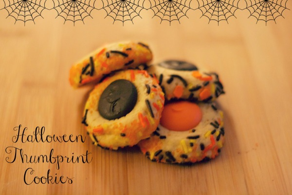 orange and black halloween thumbprint cookies, simply social blog
