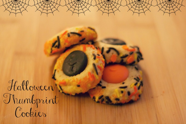 orange and black halloween thumbprint cookies, simply social blog