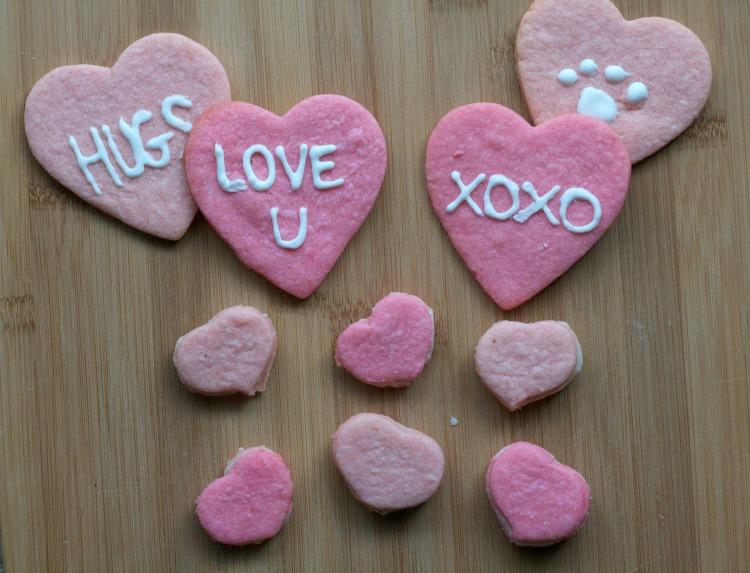 valentine heart sugar cookies, cream filled sandiwch cookies, heart shaped sandwich cookies, martha stewart recipes, heart sugar cookies, pink cookies, iced heart sugar cookies